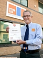 PROUD: managing director Keith Gilby with the Trusted Trader certificate