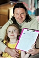 PROUD dad Neil Fotheringham and his daughter Anya with her sponsorship form.