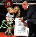 David Whaley presents an award to Leo Stott and mum Cara Oldham at the Pride in Oldham Awards. David�s great week was soon to end though