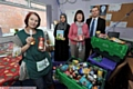 Merry Christmas (from left: Foodbank volunteer Lisa Leunig, Fateha Khano - Oldham Council Foodbank Co-ordinator, Councillor Barbara Brownridge, Simon Shuttleworth - Oldham Council Neighbourhoods Team)