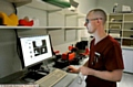 Therapy radiographer Wesley Doherty keeps a close watch on his monitor