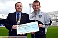 President John Walkden visited SportsDirect.com Park to present the donation to Oldham Athletic Community Trust.