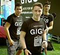 DELIGHTED: Oldhamer Aaron Murphy, left, and his two best mates have been named London�s best buskers