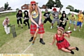 SWAPPING guitars for cricket bats... teams dressed up as their favourite rock idols for the challenge