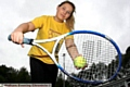 LIMBERING up: Annabelle Simister (16) gets ready to play tennis for Diggle in the Saddleworth Olympics. Pictures: PAUL STERRITT