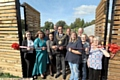 THE Mayor, Councillor Ateeque Ur-Rehman, cuts the ribbon to an open day at the popular Waterhead growing hub