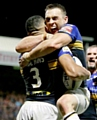 SO GOOD: Kevin Sinfield celebrates as Leeds Rhinos claim the league leaders� shield.