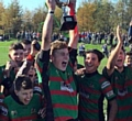 WHAT A CELEBRATION . . . Waterhead under-14s captain Callum Cameron raises the Oldham Youth and Juniors trophy.