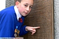 Shaw Remembrance Sunday. Leo Baker, house captain at Crompton primary school, points to his Great Great Grandfathers name , J.F. Tetlow, who fell at the Battle of the Somme, during the Great War.