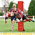 HIGH FLYER . . . Oldham�s Will Mellor dives over to score a try.