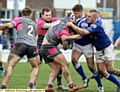 WRAPPED UP: Oldham�s Sam Gee (centre) is left with nowhere to go, but ultimate victory belonged to the Roughyeds.