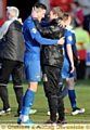 YOU�RE THE MAN: Dean Holden (right) embraces goal hero Conor Wilkinson after victory over Crewe.