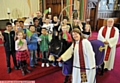 WALKABOUT: the Rev Jean Hurlston leads Bobby on a tour of the church watched by children in the congregation and vicar the Rev Derek Palmer