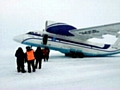 READY TO RUN: Steve and fellow runners board the plane for the Arctic