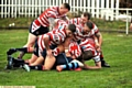 SIX Oldham players pounce on an unfortunate Coventry Bears rival during yesterday�s clash at Whitebank.