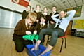 OH my aching feet . . . St Joseph�s deputy head teacher Steve Hill with pupils (back, from the left) Maya Burke-Perez, James Wilson, Kade Wrigley, Lucy Lovell. Front: Jonathan Diveney and Jasmine Carroll.