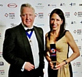 Pictured at the construction industry�s H&V Awards are Debbie Abrahams, with her gold award, and Jim Marner, president-elect of Building and Engineering Services (B&ES)