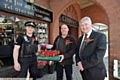 TONY on tour . . . Tony Lloyd with PC Paul Rainsford and local florist Dale Robinson