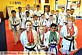 MEDAL MANIA: members of Kenny Karate Club, who struck gold, silver and bronze in recent competitions. Pictured are Katelyn Entwistle (left), Erin Joyce, Jamal Akhtar, Rosy Whittle and other medal winners behind.