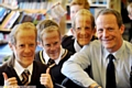 STEVE HILL times four - but only one is the real thing. Pupils wore Mr Hill masks as a tribute to their teacher. PHOTO BY DARREN ROBINSON