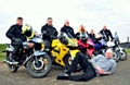 BIKER gang . . . (from left) Marc Ratcliffe, Scott Roberts, Lee Croston, Stephanie Ratcliffe, Ryan Bateson, Mick Croston and (lying down) his son Pete who will be riding a support vehicle
