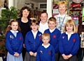 WELCOME . . . Baroness Estelle Morris with head teacher Suzanne Ashton and pupils.
