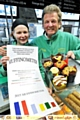 THE muffinometer never lies: head baker Grace Robinson with owner David Robinson . Picture: Darren Robinson