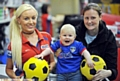 COMIC STRIP: Athletic�s new home kit for next season went on sale at the Sports Direct store in town yesterday - and there to snap up a shirt for smiling 10-month-old Emily Finnegan was mum Sarah, pictured with sales assistant Natalie McAiney.