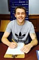 SIGN HERE . . . Athletic new George Green.