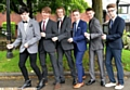 SUITED and booted: from left, Ryan Dunne, Josh Duncan, Marc Egerton, Joe Crozier, Connor White and Ole Chambers