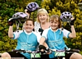 ON their bikes: Holly Taylor (left) and Katie Bissett with grandmother Maureen Oxley