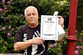 Keith with his prize certificate - all he�s taking from his win