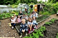 DEVASTATED . . . the Garden Gang from St Thomas�s School at the allotments. Teacher Karen Jakeman, back left, and parent Amirah Khan, back right, with children including, front from left, Jake Hacking, Frankie Birch and Heidi Verity.