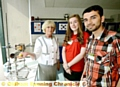 SCIENCE matters . . . Lady Ogden (Ogden Trust) is given a tour of the science lab by student Rebecca Thornley and former student Mukhtar Abdul Ghani