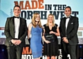 Polyflor marketing manager Tom Rollo, market manager Sonia Petherbridge, PR and communications manager Kerry Edward and manufacturing director Steve Mullholland receive the award from Insider magazine.