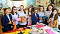 Textiles pupils with some of the dozens of items made for the African children. - (l-r) Roberta Pellowe-Bailey, Ella Shuttleworth, Yasmin Quinlan, Lydia Entwistle, Millie Johnson-Leach, Estelle Adshead, Eleyna Flitcroft, Molly Thornton.