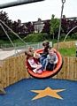 CHILDREN try out the new play area dedicated to Jamie.