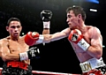 IT�S ON AGAIN . . . action from the first fight between Anthony Crolla (right) and Darleys Perez.