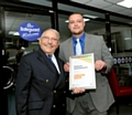 Norman Stoller presents a Get Oldham Working ambassador certificate to Ben Ingham of Safeguard Group during the event