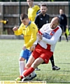 Royton's Jake Coe (left) is tackled by Andrew Pheby