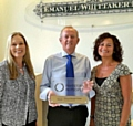 From left: Human resources managerAnna Whittaker, MD Clive Newton and partnerships manager Rukhsana Nabi with the IIP award.