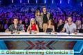 Nick, left co-stars Rita Ora, Cheryl Fernandez-Versini and Simon Cowell. Behind them are show presenters Caroline Flack and Olly Murs.