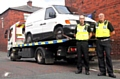 SEIZED: neighbourhood enforcement officers David Scanlon and Mark Greenhalgh with the van