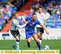 BATTLE FOR THE BALL: Shrews star Ryan Woods (left) tussles with Athletic�s David Dunn in last month�s meeting