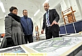 Parents Laura Holgate-Condron, Lee Condron and Barney Harle, Oldham Council�s capital works and energy manager, study the scheme. Picture: Darren Robinson