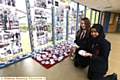 pupils Grace Lowe and Tahmina Ali with paper shoes which formed part of a display at Holocaust memorial display at Radclyffe School