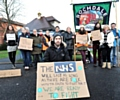 WALKOUT . . . Dr Rory Hicks and supporters outside the Royal Oldham Hospital