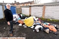 COUNCILLOR Warren Bates with the dumped rubbish