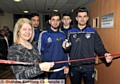 CUTTING the ribbon . . . Oldham Athletic player Jack Truelove (right) opens the lab with UCO head Helen Mathers and students (from left) Bilal Younis, Shabab Niaz and Rashad Mohammed