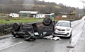 A Vauxhall Corsa lays on its roof after control was lost and it hit a stone wall at Well-I-Hole Road, Greenfield.